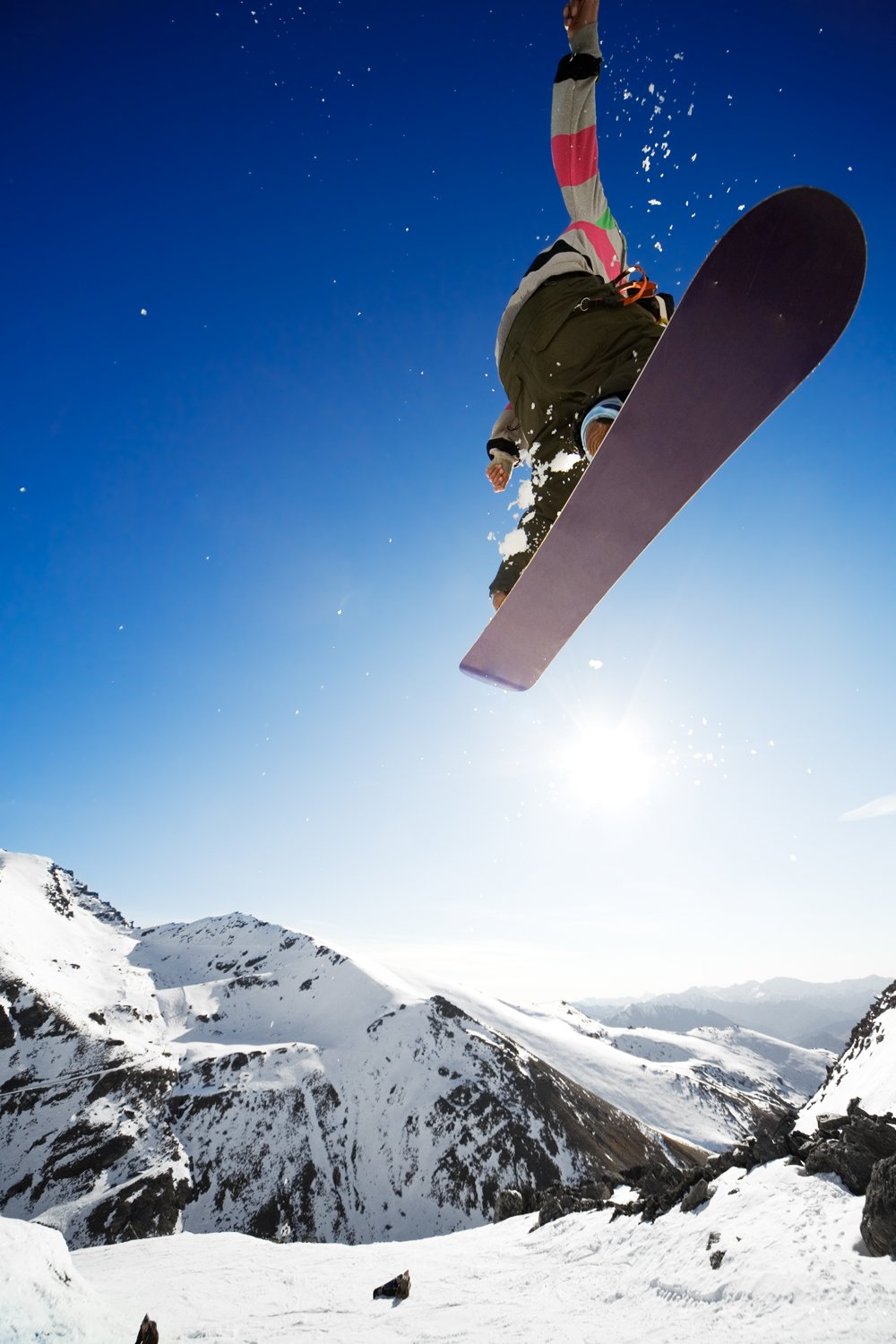 Snowboarder jumping through air sports wall mural ohpopsi snowboarder jumping through air sports wall mural amipublicfo Image collections